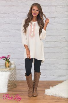 You'll definitely be remembered in this beautiful ivory tunic! We are in love with the gorgeous flowy look - it's so effortlessly chic and relaxed! It also features buttons halfway up the bodice, beautiful forest green and orange embroidered details at the neckline, and long sleeves!