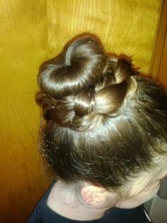 Sock bun with end hair braided around base.