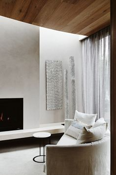 How to: white and neutral living rooms: Neutrals needn't be cold, take for example this cosy corner with Maxalto 'Crono' sofa and side table. in a modern Melbourne home.