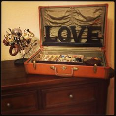 Antique suitcase used as a jewelry organizer