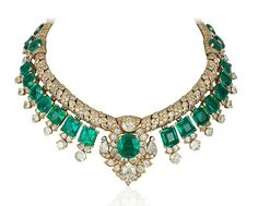 An emerald and diamond necklace by Cartier. Set with 30 Colombian emeralds weighing a total of approximately 105 carats and diamonds weighing a total of approximately carats Mounted in Gold, Circa Christie's Images Ltd. Emerald Bracelet, Gold Diamond Earrings, Emerald Jewelry, Cartier Jewelry, Diamond Pendant Necklace, Emerald Diamond, Emerald Rings, Ruby Pendant, Uncut Diamond