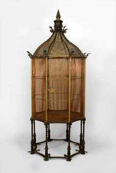 English Victorian Bronze And Copper Octagonal Shaped Monumental Bird Cage With A Gilt Pierced Dome Abd Finial Top Raised On 8 Swirl Iron Legs