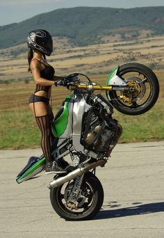hope she doesnt fall off ! ....ouch !!!