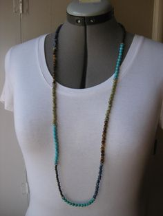 """Item #S5261 40"""" Multi bead (blues, greens, browns), silver spring ring clasp. $50."""