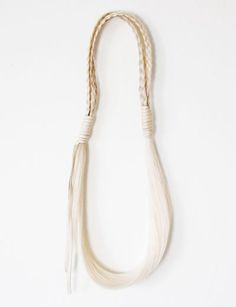 Horse hair necklace by Wendy Nichol.  I've always been drawn to horse hair.  I'm not sure why.  It could have something to do with my mother growing up on a farm with horses, but it could also just be the fact that it's flowy and beautiful.  Either way, I love this necklace!