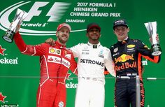 (Left-to-right): Sebastian Vettel, who finished second, Mercedes driver Hamilton and Red B...
