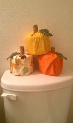 They look cute. and I bought generic fabric, so I plan to leave them out for thanksgiving too! Pumpkins made from a roll of toilet paper.