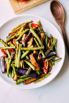 This Chinese eggplant string bean stir-fry is an easy, delicious dish with only 10 ingredients, most of which you probably already have in your pantry.