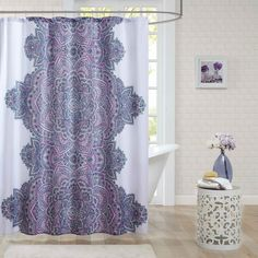 The Katarina Shower Curtain provides an eye-catching update to your bathroom. A beautiful floral medallion motif runs up the center of the shower curtain in vibrant colors of fuchsia, teal, and purple