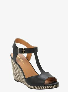Take a peep at these cuties. A black and tan woven wedge gives them some fun texture. Finished off with faux leather, this t-strap sandal is on point.