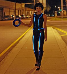 Tron cosplay baby. Do you want your Tron costume to glow like this one, created by designer Syuzi? Then you need to learn about electroluminescent wire. There's a great tutorial over on Adafruit that teaches you everything you need for Tron cosplay.