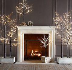 Winter decor ideas. Pre-lit trees. This looks just like a fairytale!