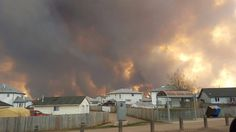 Smoke rises from a wildfire outside of Fort McMurray, Alberta, Tuesday, May 3, 2016. The entire population of the Canadian oil sands city of Fort McMurray, h...