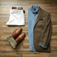 Essential outfit for men with blue shirt, dark jacket, brown shoes and white pants