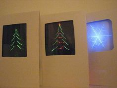 Christmas Cards lit with LED lights...would never be able to make them myself, but they look super cool!!