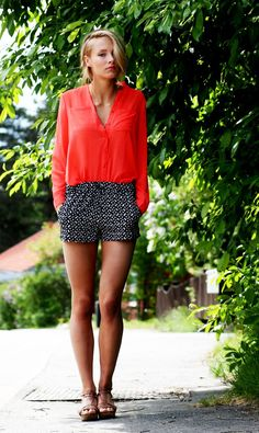 red top + patterned bold shorts