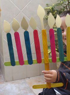 Chanukah decoration from popsicle sticks (I think they must be tongue depressors, too big for popsicle sticks)