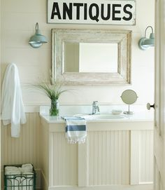 "An eye-catching ""Antiques"" sign adds age in the bathroom of this colorful Texas home.   - CountryLiving.com"