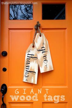 "Spell out your excitement for autumn with these oversized wooden tags instead of hanging a wreath on your door. While ""Give Thanks"" welcomes Thanksgiving, you could expand the lifespan of this decoration by writing ""Happy Fall"" instead."