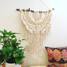 Macrame, plants and pillow