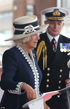 After a short speech Camilla declared: 'I name this ship Prince of Wales. May God bless her and all who sail in her.' She pressed a button to trigger the smashing of a bottle of Laphroaig whisky against the ship's hull