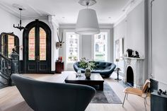 Love the contrast of old, new, charcoal, white and gray with little pops of color. Quietly Off Kilter - NYTimes.com