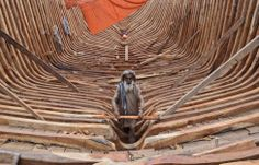 A Pakistani carpenter works on a fishing boat at the harbor of Karachi. (AP)