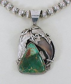 Native American sterling silver Turquoise and Claw Pendant