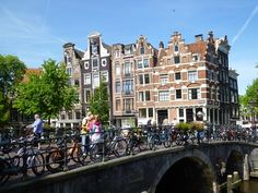 Want to visit Amsterdam on foot? Use this guide to the best walking spots in Amsterdam including the Vondelpark, Brouwersgracht, Noord and other highlights. Visit Amsterdam, Amsterdam Travel, Amsterdam Red Light District, New Palace, Cities In Europe, European Destination, How To Be Likeable, Travel Abroad, Walking Tour