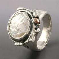 Coin pearl ring by Sherry Tinsman. Inspired by nature, her home along the Delaware River,  and her English heritage  her pieces feature distinctive patterns and shapes which characterize her work. *Natural elements of the earth and relics of ancient architecture. Pieces are hand fabricated using sterling silver, 14k yellow, or rose gold accents. To add a whimsical elegance, some pieces are set with semi-precious stones or pearls.  100% handmade in studio. See more at Quirks of Art! $215