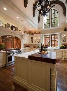 Dream French Country Kitchen ~ design ideas, windows, island with raised butcher-block counter, back-splash .just stunning. Beautiful Kitchens, Cool Kitchens, Dream Kitchens, Old World Kitchens, Style At Home, Houses Architecture, Home Design, Design Ideas, Deco Design