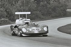 Hall in his Chaparral 2G closes on Charlie Hayes driving a much modified McKee Mk.7 at Road America, 1967. Hayes' talent was largely responsible for the old McKee being as fast as it was. This was the opening race of the 1967 season and the 2G really wasn't ready. Chaparral's building and racing the 2F in Europe limited the effort applied to the 2G. Firestone being well behind Goodyear was another contributor to the relatively poor debut of the 2G. Dave Friedman photo.