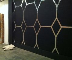 love this foil tape wall diy. the silver looks so fab against the black! love!