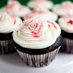 Perfect festive holiday cupcake. Moist chocolate cake topped with peppermint butter cream and crunchy candy cane pieces.