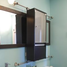 Amazing The Mirror Door Slides Back And Forth On This Modern Medicine Cabinet.