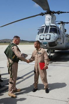 The Last Ch-46 Pilot - Maj. Gen. Andrew W. O'Donnell Jr., left, the commanding general of 3rd Marine Aircraft Wing, congratulates 1st Lt. Zerbin Singleton, right, as the last CH-46 Sea Knight pilot upon the completion of his final check flight aboard Marine Corps Air Station Camp Pendleton, May 23, 2012. The CH-46 is slowly phasing out, to be replaced by the versatile tiltrotor MV-22B Osprey. Photographer: Sgt Justin M. Martinez DVIDS