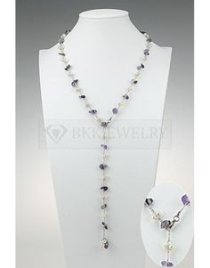 Pearl Y necklace. Purple Amethyst extra long Y shaped necklace of Japanese silk with natural freshwater pearls and purple Amethyst stones  This is an extra long necklace made of individually knitted strands of Japanese silk that have been carefully twisted together. Each strand carries precious freshwater pearls and stunning purple Amethyst stones that add emphasis to the subtle coloring of the pearls.  Product Specification: Fresh water pearls Y necklace-MSN1311  Freshwater pearl + Amethyst…