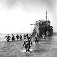 American soldiers land on the shore near Salerno during the Allied invasion of Italy, photographed by George Rodger (September 3, 1943). The main force landed around Salerno on the western coast in Operation Avalanche, while two supporting operations took place in Calabria (Operation Baytown) and Taranto (Operation Slapstick).