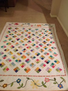 "Quilt for my niece in ""Confetti"" pattern, but with added borders and appliqué to make it twin length"