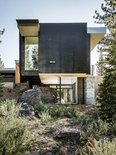 Throughout the site, the original bolders that have been left untouched are evident as the home engulfs them into its design. #hometour #minimalist #concrete