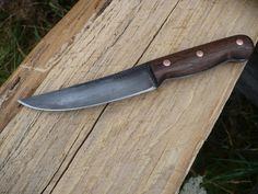 The belt knife made from an old Nicholson file, black walnut and is antiqued