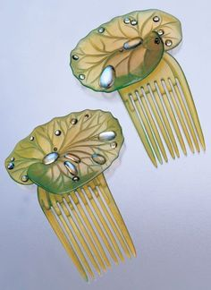 ELLA NAPER (1886-1972), Art Nouveau 'Lily-pad' hair combs, composed of green-tinted horn and moonstones, British, c.1906, fitted case. #EllaNaper #ArtNouveau #comb