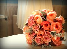 coral and peach rose bouquet with gray dusty miller