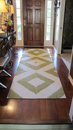Really cool product = FLOR carpet squares--many pattern possibilities! Pretty modern rug. Saw a similar one at http://www.caravanrug.com/modern-rugs-article-111-101-508