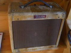 This a fender Tweed amp has seen a little action...