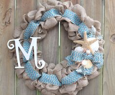 This coastal inspired burlap wreath is the perfect accent to any home or beach home. It is made of burlap with burlap ribbon. It has starfish