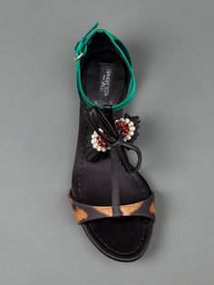 Green sandals from Giambattista Valli featuring a leopard print toe strap, a t-bar front with pearl embellished tassels, a green buckled ankle strap and back panel and a flat sole Pearl Shoes, Green Sandals, Embellished Sandals, Designer Sandals, Giambattista Valli, Bottega Veneta, Birkenstock, Ankle Strap, Flip Flops