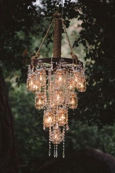 Vintage Wedding Ideas with the Cutest Details Beautiful mason jar chandelier! The post Vintage Wedding Ideas with the Cutest Details appeared first on Dome Decoration. Chandelier Wedding Decor, Mason Jar Chandelier, Diy Chandelier, Mason Jar Lighting, Outdoor Chandelier, Wedding Lanterns, Wagon Wheel Chandelier Diy, Pendant Lamps, Wagon Wheel Decor