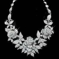Glamorous crystal and diamond floral bib necklace with sparkling roses and butterflies. Bling bling all around the room