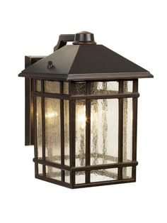 """The Craftsman-style lanterns on either side of the door are in perfect sync with the home's look. Jardin du Jour Sierra Craftsman 11""""-tall outdoor wall light in rubbed bronze, $100, lampsplus.com"""